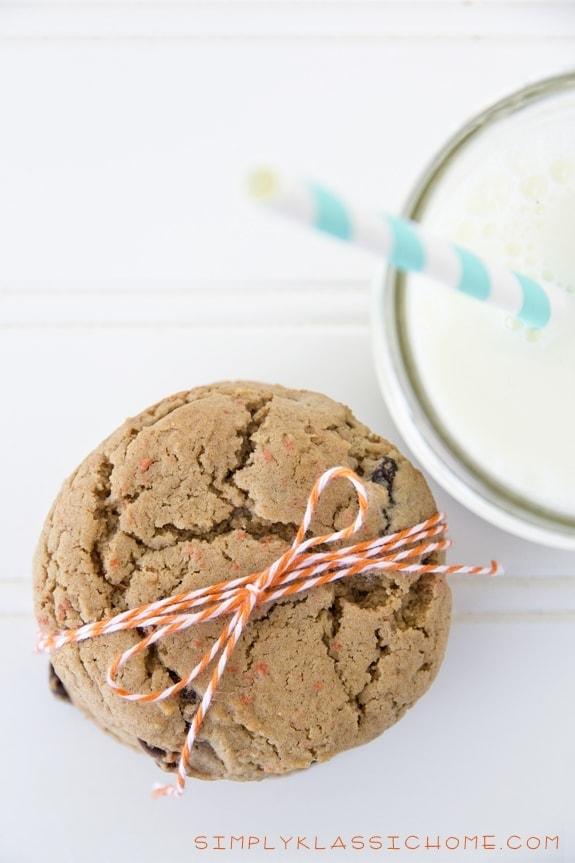 A close up of cookies and a glass of milk