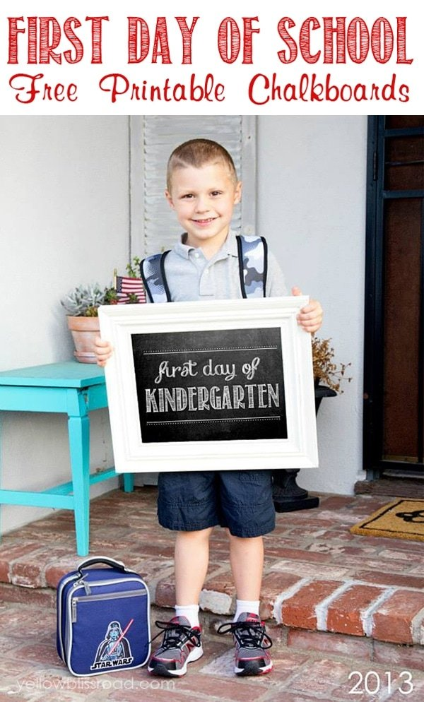 A child holding a first day of school sign for kindergarten.