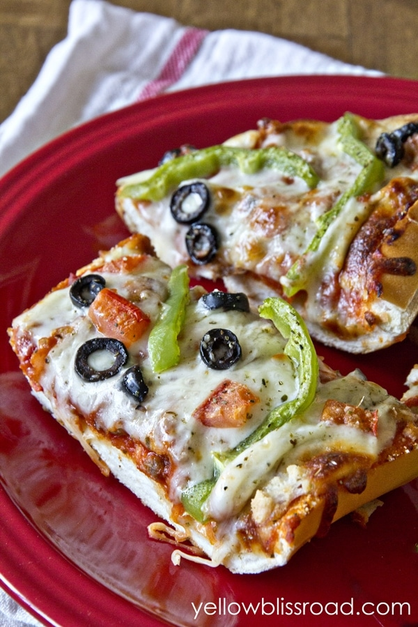 A plate of french bread pizza