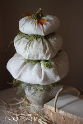 A close up of a fabric pumpkin topiary