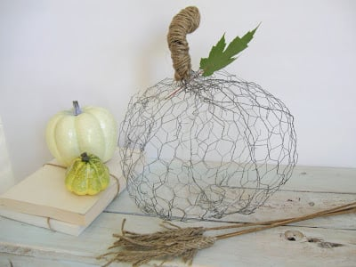 A wire pumpkin on a table