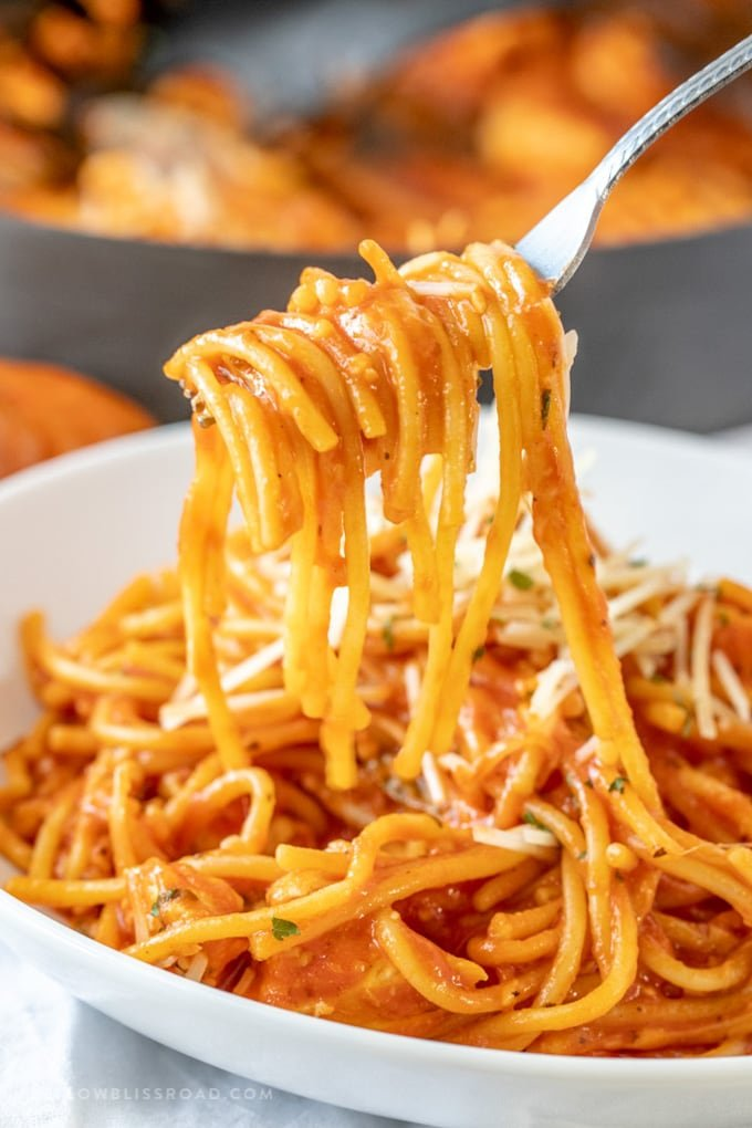 One Pot Chicken Spaghetti lifted off the plate on a fork.