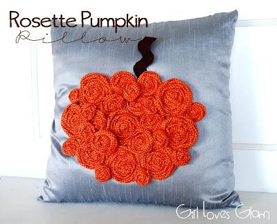 A close up of a rosette pumpkin pillow