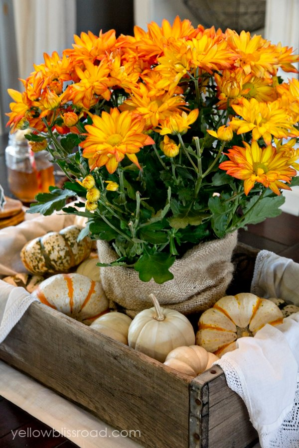 Flowers and pumpkin decor on a table