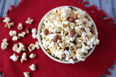 Popcorn in a bowl on a red tablecloth
