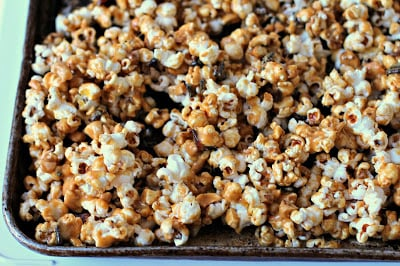 A close up of Popcorn with Chocolate and Caramel