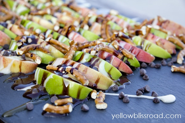 A plate of apple slices with toppings