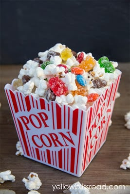 A container of popcorn and candy