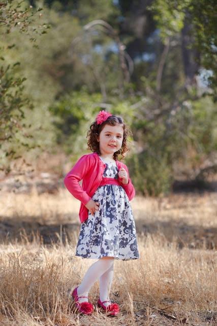 A little girl standing in a field