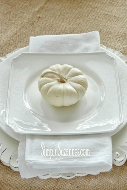 A white pumpkin sitting on a plate