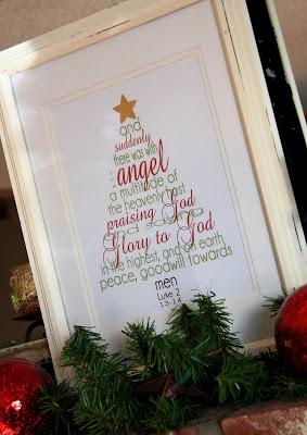 A framed Christmas tree sign