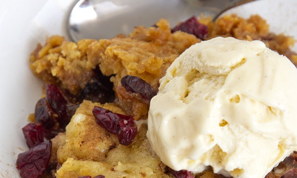 A plate of cobbler with ice cream on top