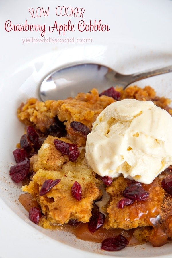 Slow Cooker Apple Cranberry Cobbler - Made with cake mix for an easy warm dessert! Perfect for holiday get-togethers!