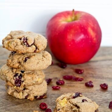 Stack of cookies next to an apple