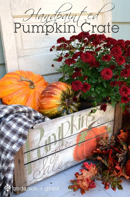 Pumpkins and pumpkin sign with flowers