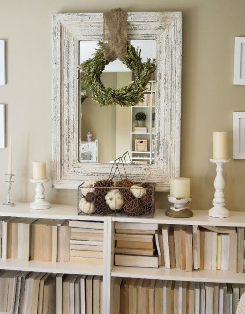 Decorated room with white bookshelf and mirror