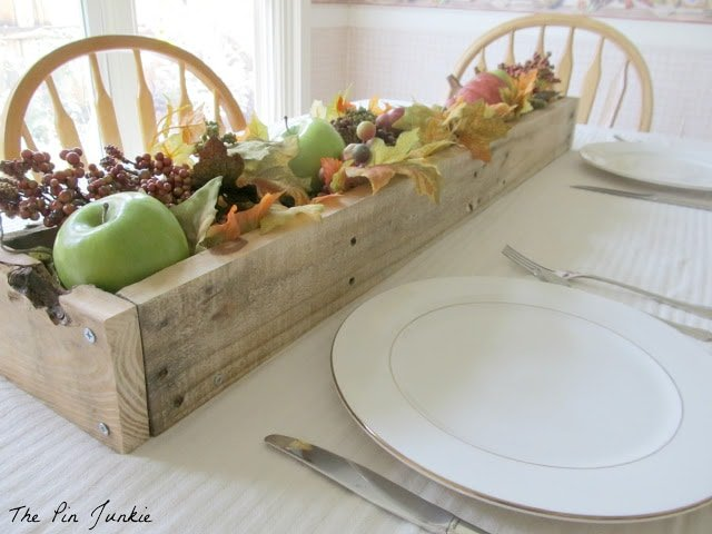 Dining table with planter box and decor
