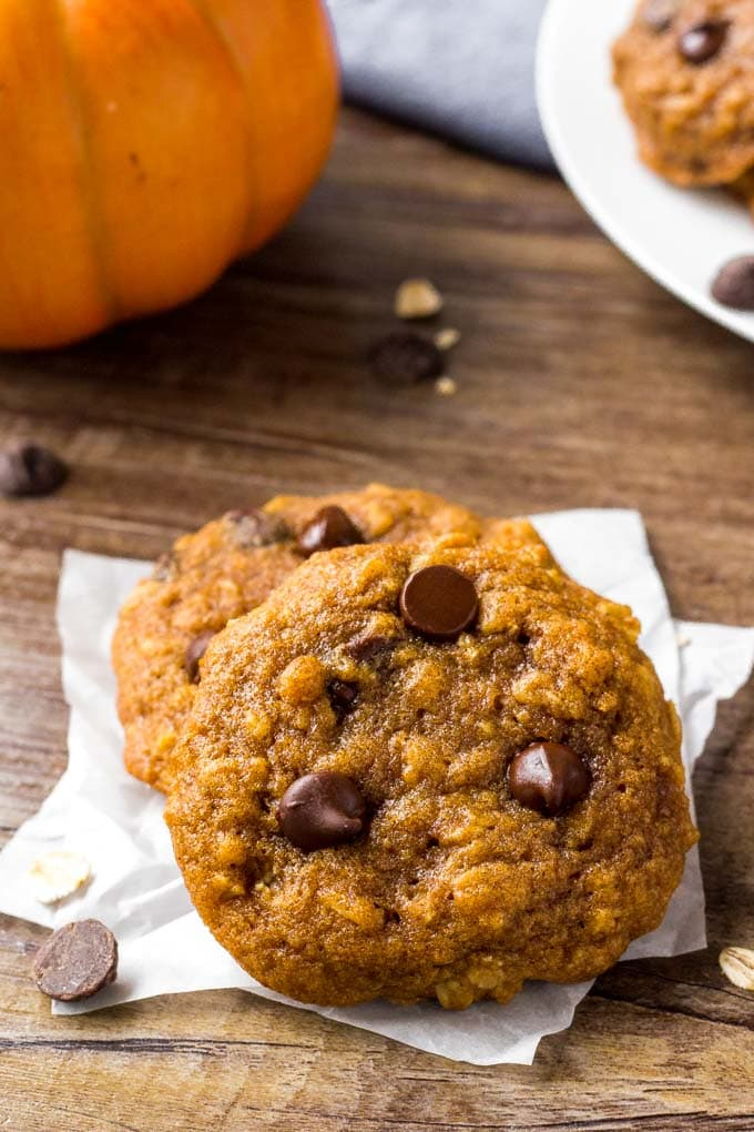 Two Oatmeal Pumpkin Chocolate Chip Cookies stacked together.