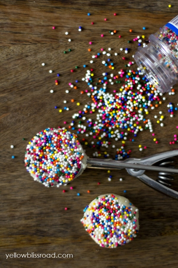Dip cookie dough into sprinkles before releasing from the cookie scoop! Genius!