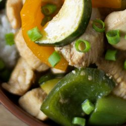 A close up of chicken and vegetables