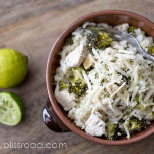 A close up of a bowl of chicken, broccoli and rice