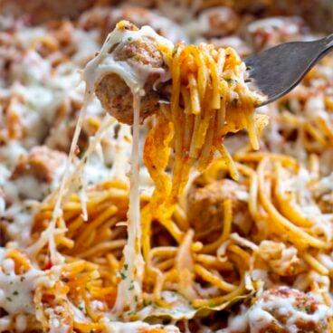 A close up of spaghetti and meatballs