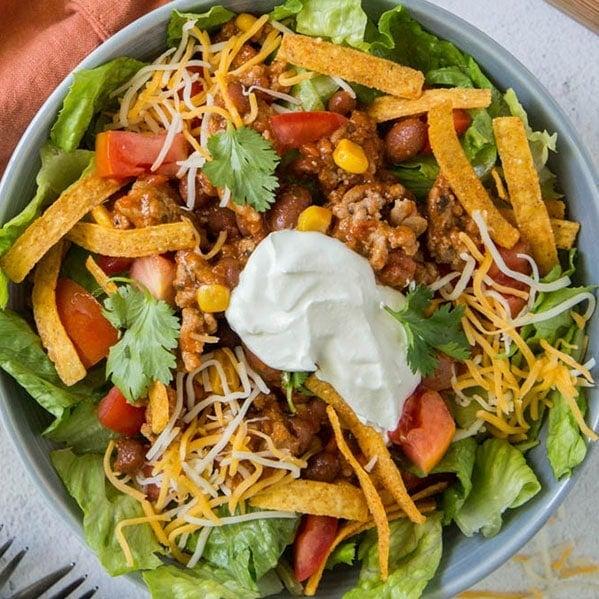 a close up image of a taco salad