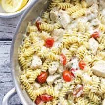 A pan of chicken, tomatoes, and pasta