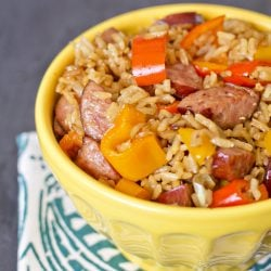 A bowl of sausage, rice, and peppers