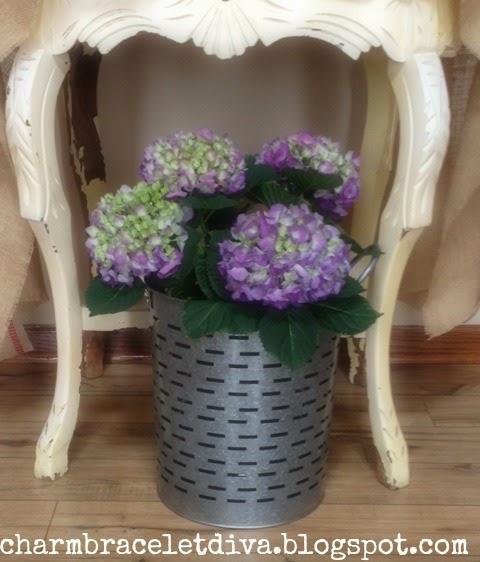 A vase with purple hydrangeas