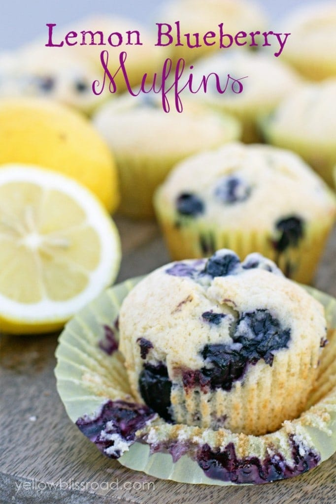A lemon blueberry muffins with the muffin paper peeled back. Title of the recipe is on the image.