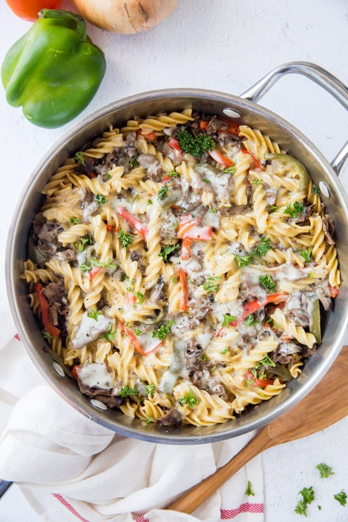 An overhead shot of a pan with philly cheesteak pasta