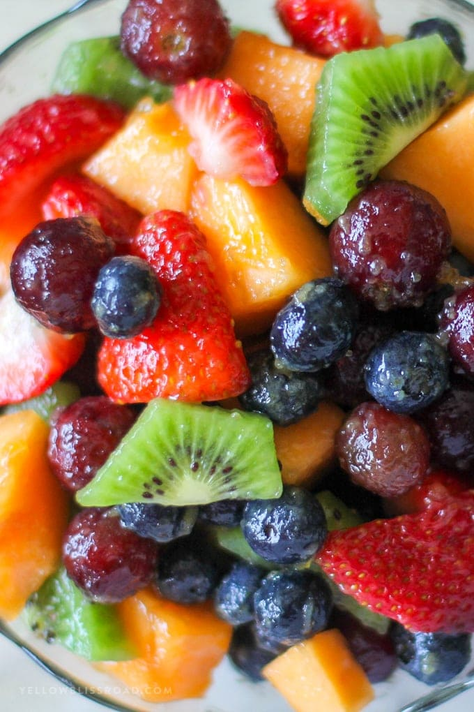 close up of fruit salad in a bowl with a vanilla pudding fruit salad dressing
