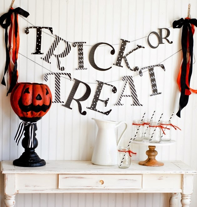 Trick or treat sign on wall with Halloween decor