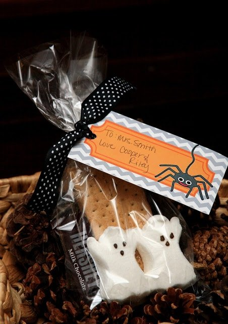 Halloween candy in a bag with a gift tag