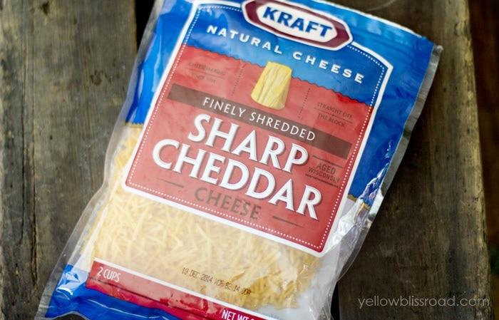 A bag of shredded sharp cheddar cheese