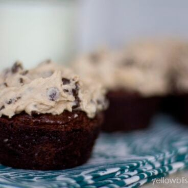 A close up of cupcakes with frosting