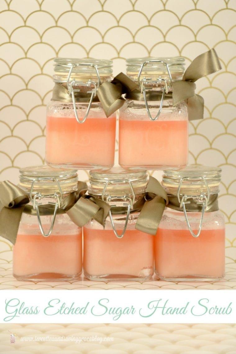 Stack of jars with pink sugar scrub