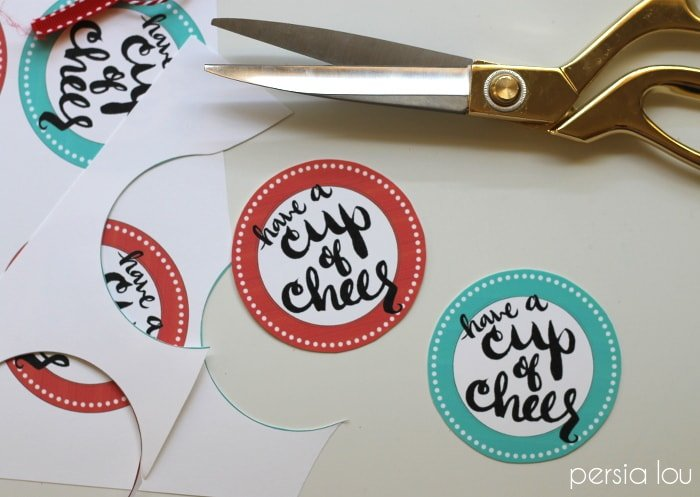 A pair of scissors and printed gift tags