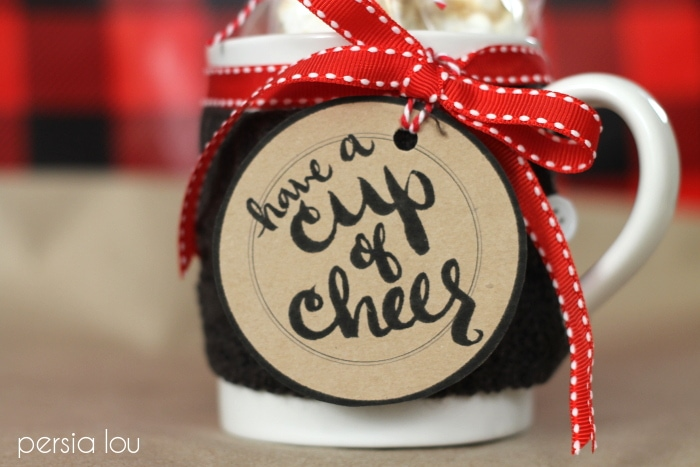 """Close up of a decorated mug with tag that says \""""Have A Cup Of Cheer\"""""""
