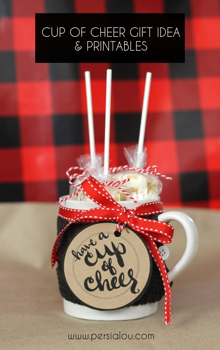"""Close up of cup of treats with sign that says \""""Have A Cup of Cheer\"""""""