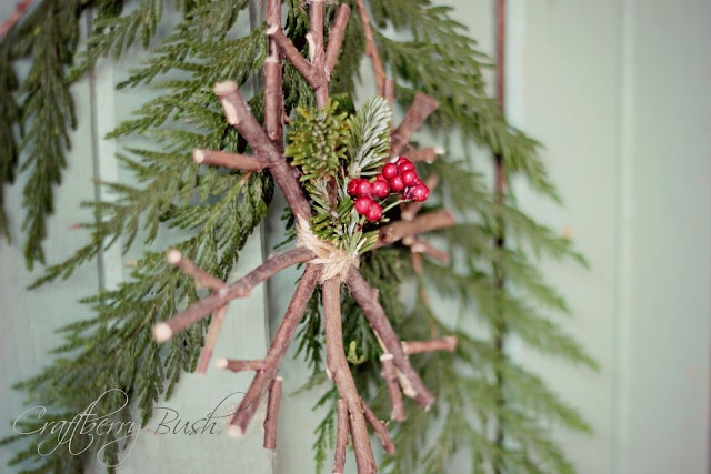 A twig ornament on a tree branch