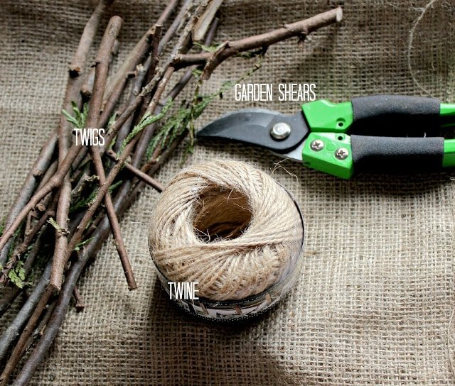 Twigs, twin and garden shears on a table