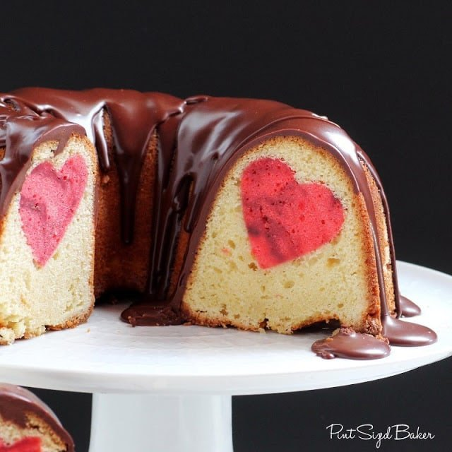 A chocolate covered bundt cake with heart inside