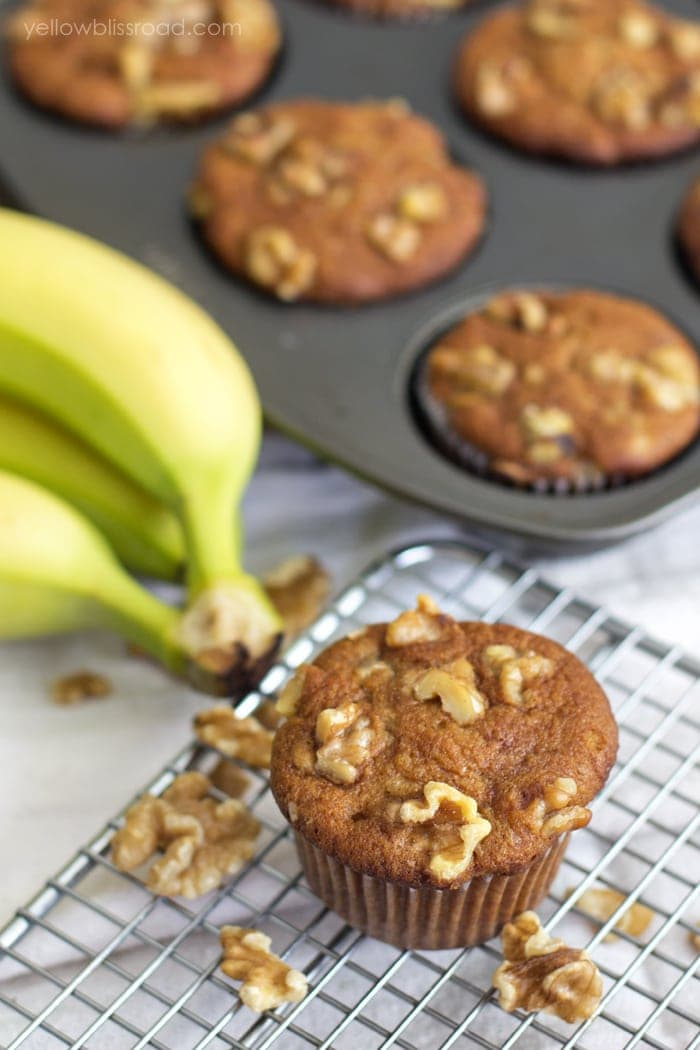 sour cream Banana Muffins on a wire rack
