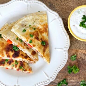 A plate of quesadillas on a table