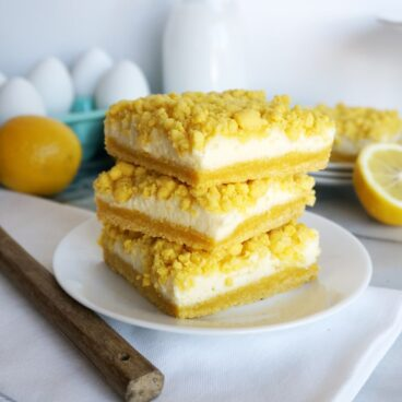 A stack of lemon bars on a plate