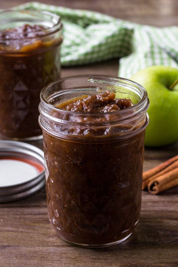 A jar filled with crockpot apple butter.
