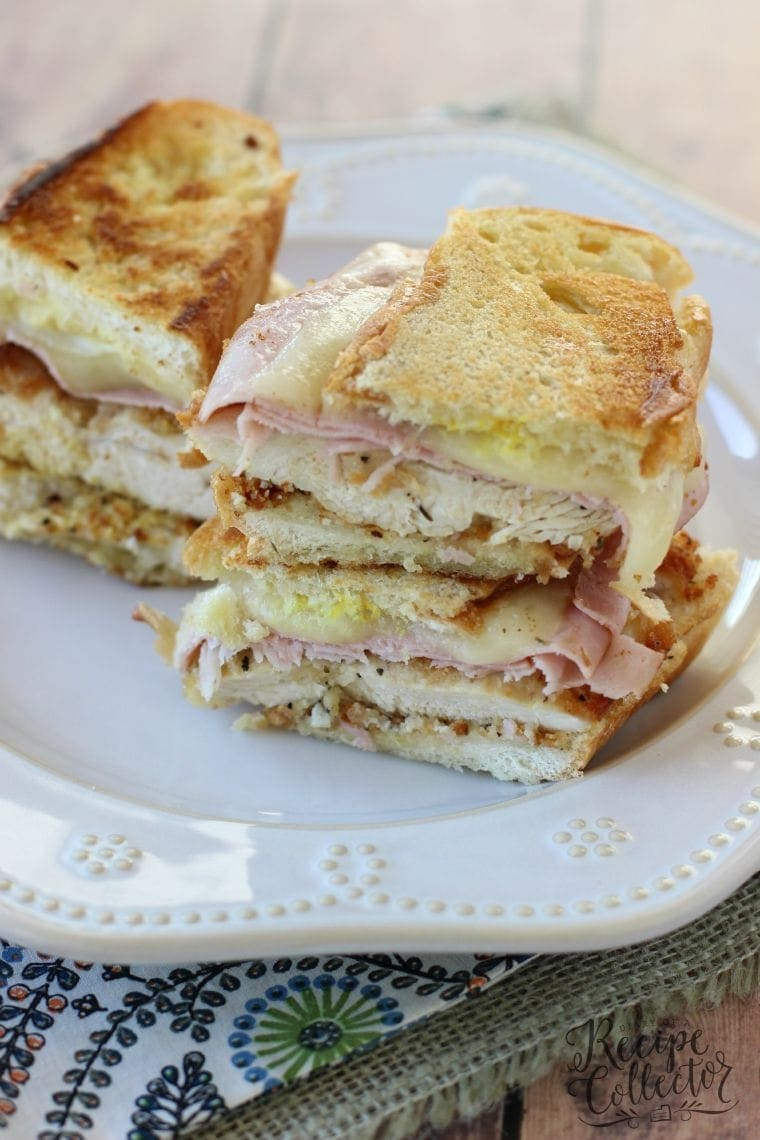 Chicken Cordon Bleu Panini - A perfectly hot-pressed sandwich filled with breaded chicken, thinly sliced ham, and provolone cheese.