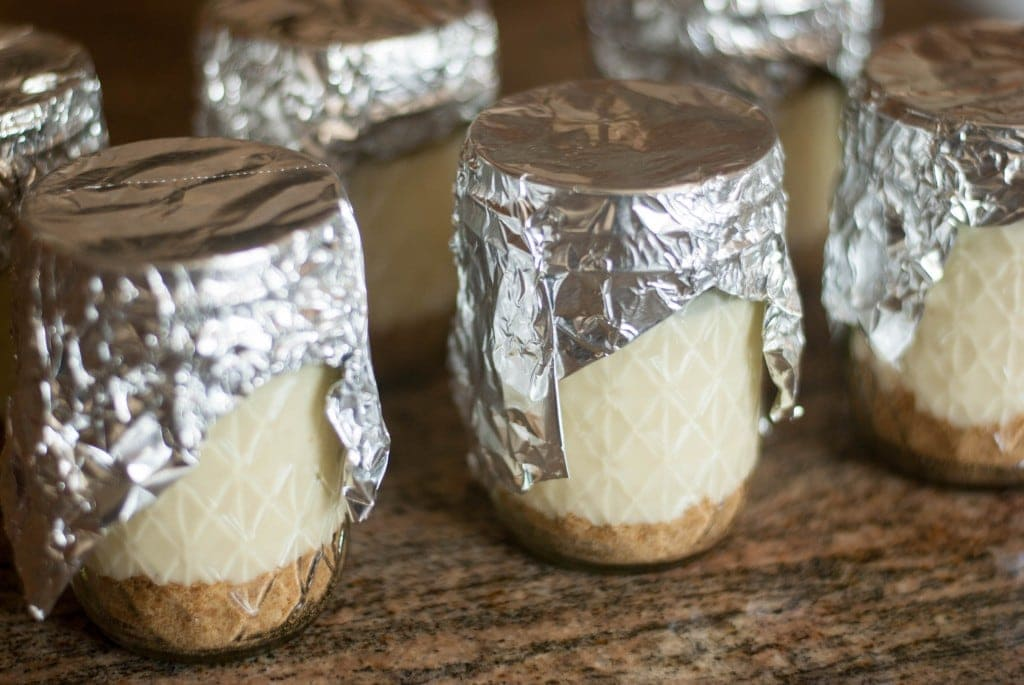 Jars of cheesecake on a table